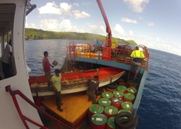 Unloading MV Liahona at first stop - Kabara Island